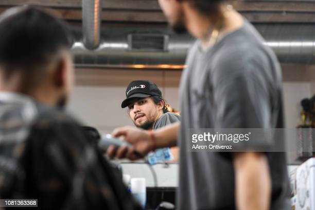 Barber Josue 'Sway' Navarro checks his work in the mirror as he cuts on Gerardo Arredondo at Bellwether Barbershop on Wednesday January 9 2019...