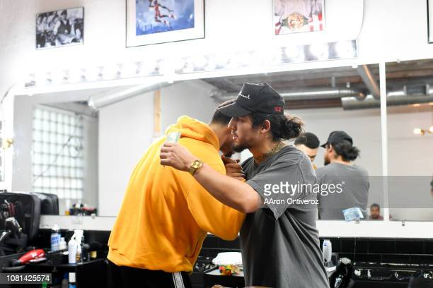 Barber Josue 'Sway' Navarro hugs Denver Nuggets guard Jamal Murray after giving him a fresh cut at Bellwether Barbershop on Wednesday January 9 2019...