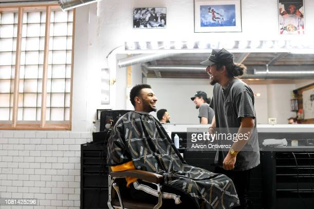 Barber Josue 'Sway' Navarro laughs as he jokes with Denver Nuggets guard Jamal Murray at Bellwether Barbershop on Wednesday January 9 2019 Navarro is...