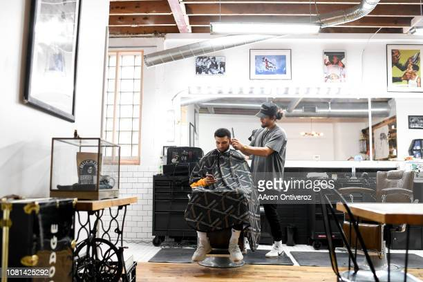 Barber Josue 'Sway' Navarro works on Denver Nuggets guard Jamal Murray at Bellwether Barbershop on Wednesday January 9 2019 Navarro is the mind...