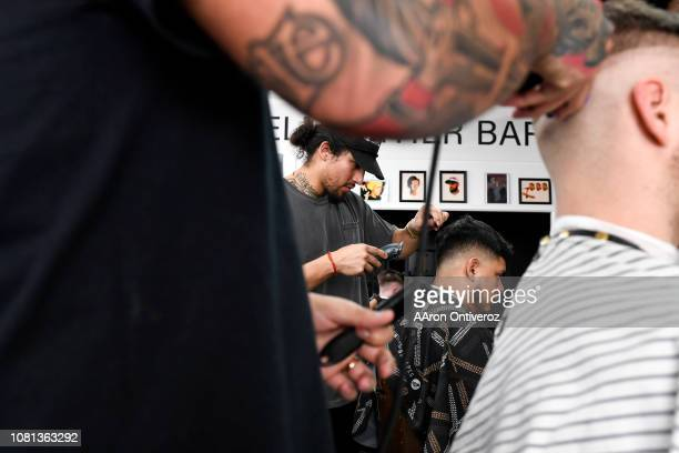 Barber Josue 'Sway' Navarro works on Gerardo Arredondo as fellow barber Gabriel Maestas works on Elijah DeFrees at Bellwether Barbershop on Wednesday...