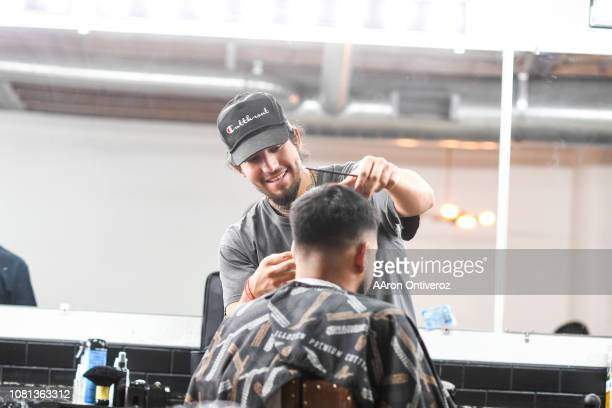 Barber Josue 'Sway' Navarro works on Gerardo Arredondo at Bellwether Barbershop on Wednesday January 9 2019 Navarro who was born in Durango Durango...