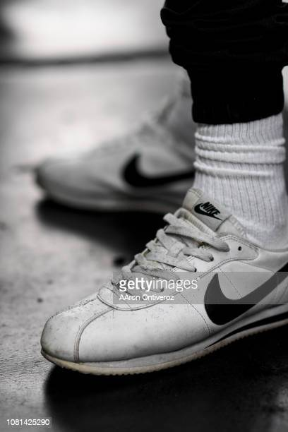 Barber Josue 'Sway' Navarro's Nike Cortez sneakers are covered in hair clippings at Bellwether Barbershop on Wednesday January 9 2019 Navarro who was...