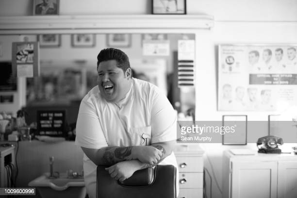 barber laughing in work station