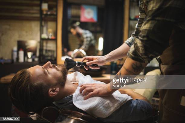 Barber Powdering Client's Neck