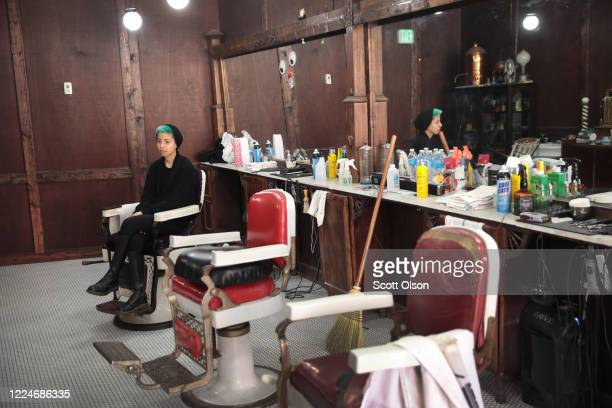 Barber Sara Gumbiner waits for customers at Gatsby's Barber Shoppe and Shave Parlor on May 13, 2020 in Chesterton, Indiana. Recently, Indiana began...