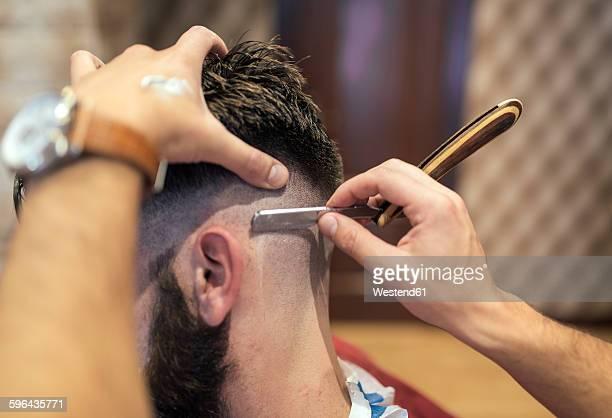 Barber shaving head of a customer