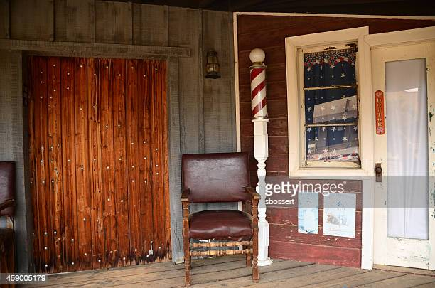 barber shop in pioneertown, california - barber pole stock photos and pictures