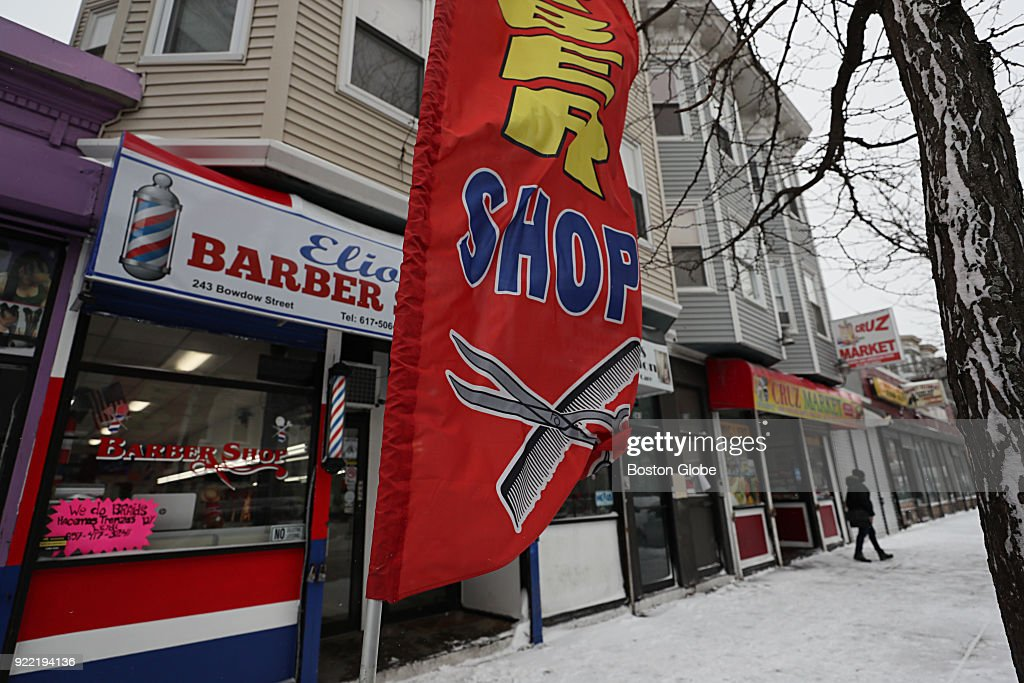 A barber shop on Bowdoin Street in the Dorchester neighborhood of Boston is pictured on Jan. 30, 2018. Immigrant-owned hair salons and barbershops dominate the small business scene in the Bowdoin/Geneva area of Dorchester. Most of them are cash only operations that may not survive gentrification pressures if they can't expand their customer base. The nonprofit Bowdoin Geneva Main Streets is hoping to close the 'digital divide' by using grant funding to connect the hair salons and barbershops with Square register programs.