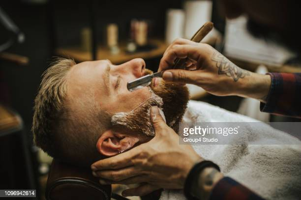 barber shop - shaving stock pictures, royalty-free photos & images