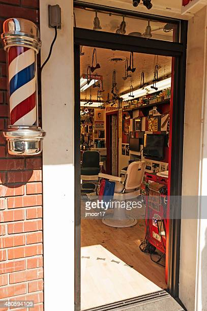 barber shop - barber pole stock photos and pictures