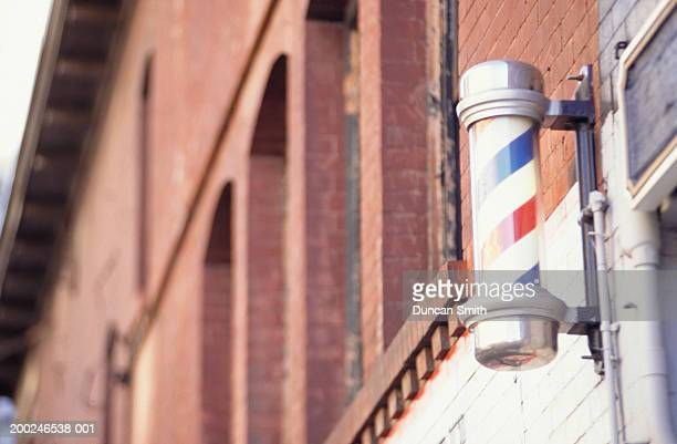 barber shop pole, (low angle view) - barber pole stock photos and pictures