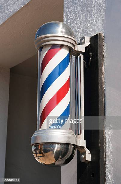 Barber Shop Pole Sign in Classic Stripe Design Outside Storefront