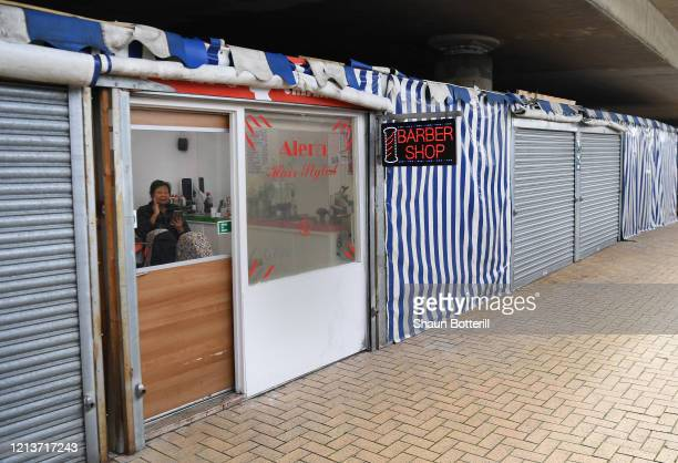 A barber shop remains open in the market area of Centre MK on March 20 2020 in Milton Keynes Coronavirus has spread to at least 182 countries...