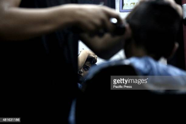 Barber shops working late at night due to a large number of citizens shaving their heads for the end Ramadan This is the atmosphere of Eid alFitr...
