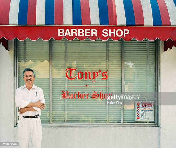 barber standing outside his shop - barber stock pictures, royalty-free photos & images