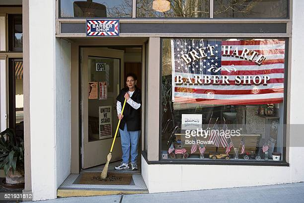 Barber Sweeping Barbershop Doorway