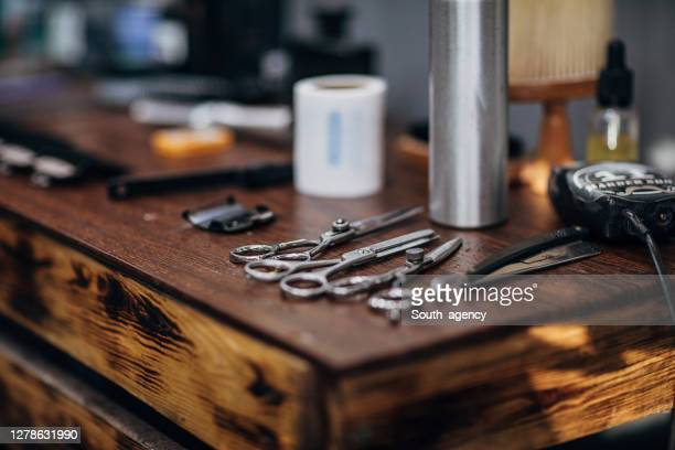 barber tools on wooden shelf at the barber shop - barber stock pictures, royalty-free photos & images