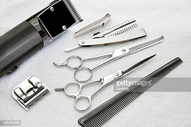 Barber tools, shears, clipper, razor, comb on a terry towel