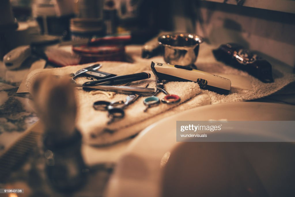 Barber vintage tools for beard grooming in retro barber shop : Stock Photo