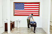 barber washing clients hair before hair