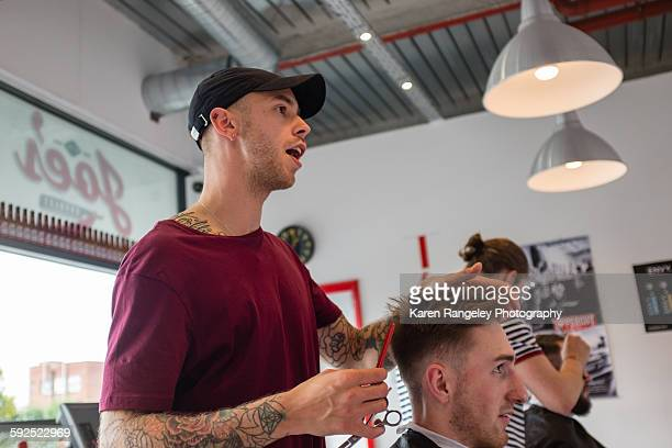 Barber Will chats to client Alex about how to best style his quiff