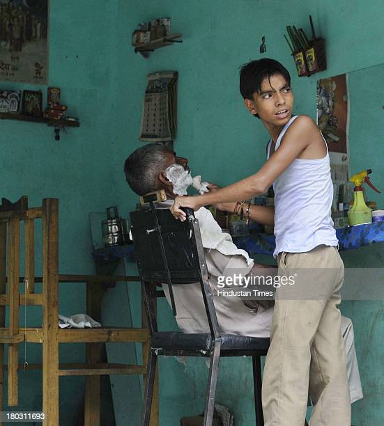 A barber working in his shop as curfew was relaxed in Kawal village from where the communal violence started on September 11 2013 in Muzaffarnagar...