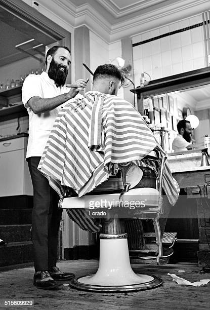 barber working on client in barbershop