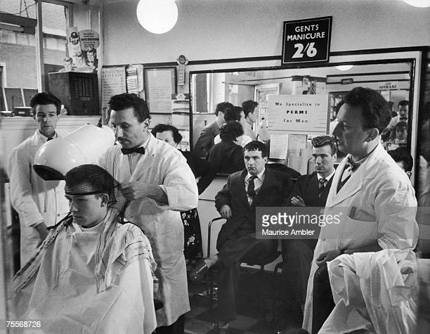 Barbers and customers at Angel Rose's barber's shop in Tottenham Court Road London 13th November 1954 Original publication Picture Post 7389 Not Too...