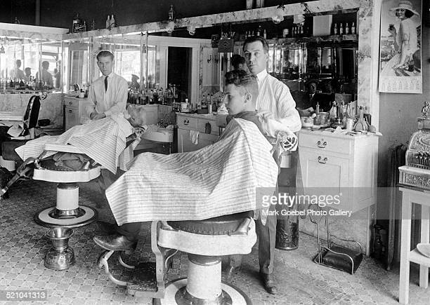 Barbers and customers in barber shop October 1922