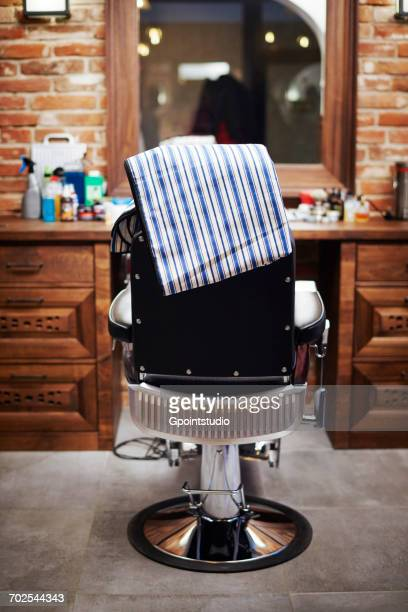 barbers chair, rear view - 美容室 椅子 ストックフォトと画像