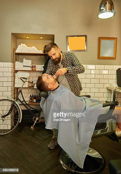 Barbers working in hair salon