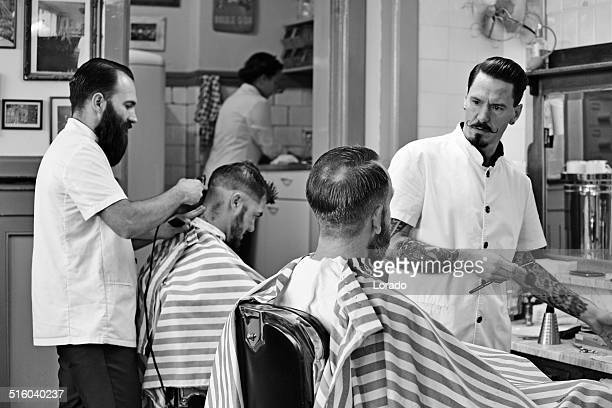 barbers working on customers