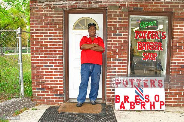 barbershop owner in front of his own barber shop in pensacola, florida, usa - gulf coast states fotografías e imágenes de stock