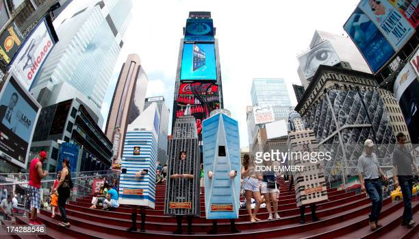 A barbershop quartet named The Broadscrapers costumed in 10foottall replicas of the Citicorp Empire State Freedom Tower and Chysler Buildingl sing in...
