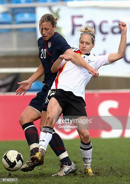 Barbett Peter of Germany and Abby Wambach of USA battle for the ball during the Women Algarve Cup match between Germany and USA on March 3, 2010 in...