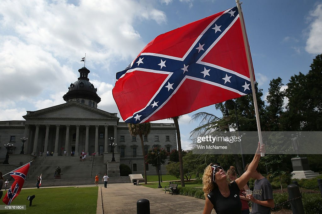Barbie Byrd, of Columbia, South Carolina joins a group of demonstrators on the grounds of the South Carolina State House calling for the Confederate flag to remain on the State House grounds June 27, 2015 in Columbia, South Carolina. Earlier in the week South Carolina Gov. Nikki Haley expressed support for removing the Confederate flag from the State House grounds in the wake of the nine murders at Mother Emanuel A.M.E. Church in Charleston, South Carolina.
