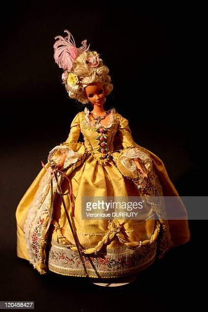 Barbie celebrates her 50th anniversary Claude Brabant with her 300 Barbie dolls in Paris France on February 02 2009 Costume of queen MarieAntoinette...