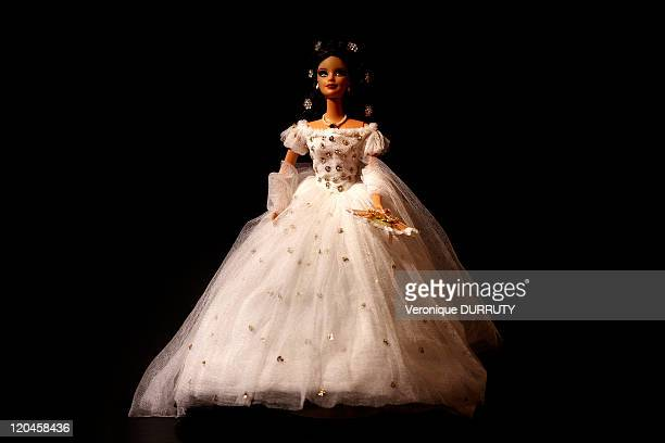 Barbie celebrates her 50th anniversary Claude Brabant with her 300 Barbie dolls in Paris France on February 02 2009 Costume of empress Elisabeth...