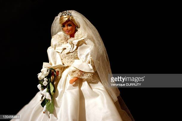 Barbie celebrates her 50th anniversary Claude Brabant with her 300 Barbie dolls in Paris France on February 02 2009 Costume of the bridaldress of...