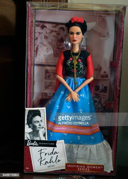 A Barbie doll depicting late Mexican artist Frida Kahlo is exhibited alongside other commercial products at her sister's house in the neighborhood of...