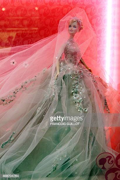 """Barbie doll dressed up in a creation of Lebanese designer Elie Saab is displayed on April 6, 2009 in Paris during the """"Barbie Fashion show 2009"""", an..."""
