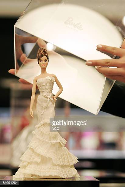 A Barbie doll is shown at the opening of the world first Barbie flagshop on February 20 2009 in Shanghai China The world first Barbie flagshop will...