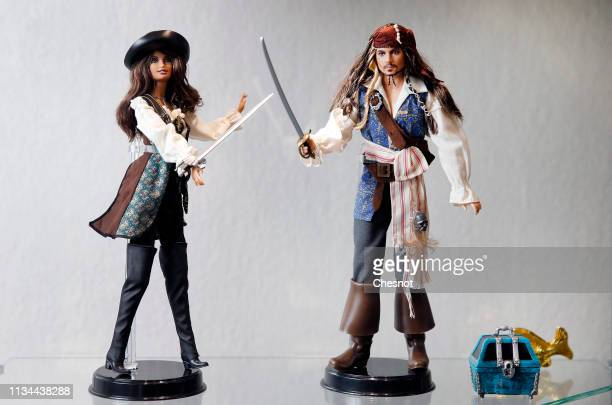 Barbie doll representing actress Penelope Cruz and a Ken doll representing US actor Johnny Depp are displayed are displayed during an exceptional...