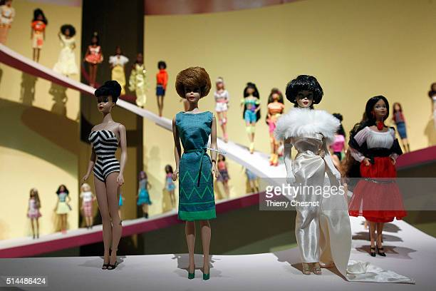 Barbie dolls are displayed during the exhibition 'Barbie life of an icon' at the Museum of Decorative Arts as part of the Paris Fashion Week...
