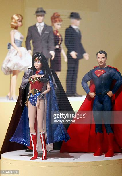 Barbie dolls dressed as Wonder Woman and Superman are displayed during the exhibition 'Barbie life of an icon' at the Museum of Decorative Arts as...