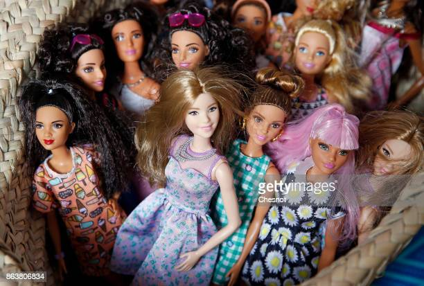 Barbie dolls from the 2017 Barbie Fashionistas collection are displayed during an exhibition at Hotel Le Moliere on October 20 2017 in Paris France...