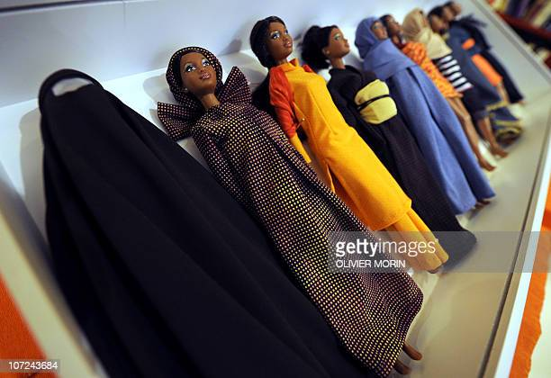 Barbies wearing cultural clothes from around the world including a Burkha are displayed during a touring exhibition at a book store in downtown Milan...