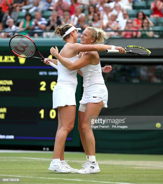Barbora Krejcikova and Katerina Siniakova celebrate winning the Ladies' doubles final on day twelve of the Wimbledon Championships at the All England...