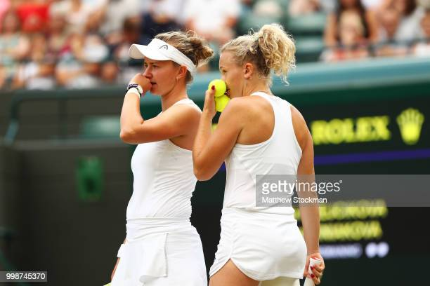 Barbora Krejcikova and Katerina Siniakova of Czech Republic discuss tactics during the Ladies' Doubles final against Nicole Melichar of The United...